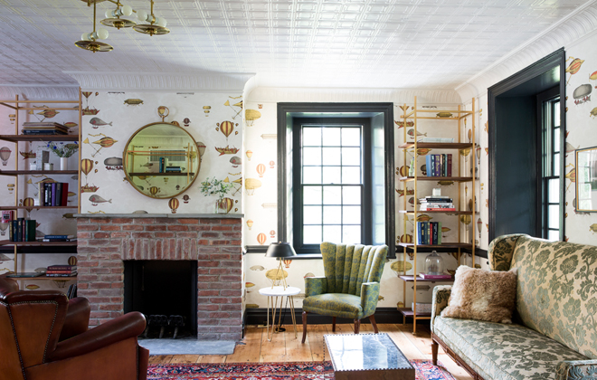 One of the cozy common areas in the house, complete with Fornasetti Wallpaper - my favorite!