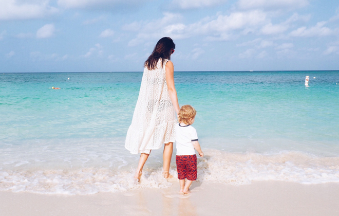 Sarah and her son on the beach.